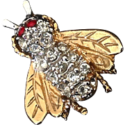 Rhinestone bee or fly pin with red rhinestone eyes