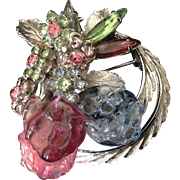 Vendome Silver tone circle pin with textured glass beads and multicolored rhinestone flowers.