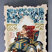 Valentine greeting card with Cupid driving an automobile
