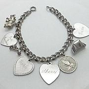 Vintage Sterling Silver Charm Bracelet 8 Charms