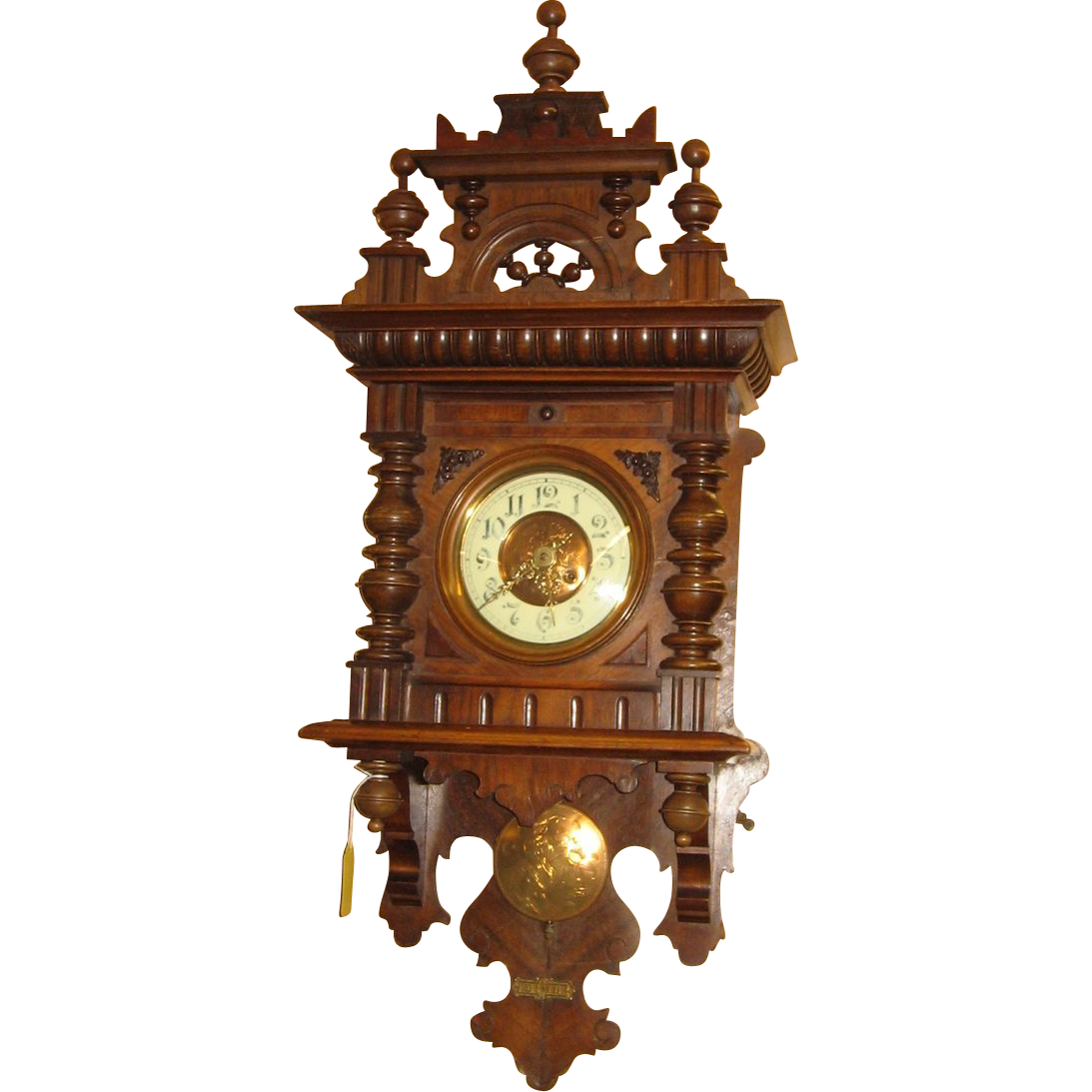 Large german carved free swinger wall clock from rubylane