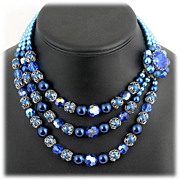 Blue Triple Strand Faux Pearl and Aurora Borealis Beaded Necklace with Accent Clasp.