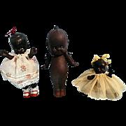 Three Black Bisque Americana Dolls Including Black Kewpie