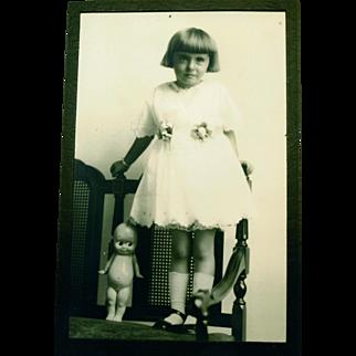 Cute Girl and Kewpie Doll