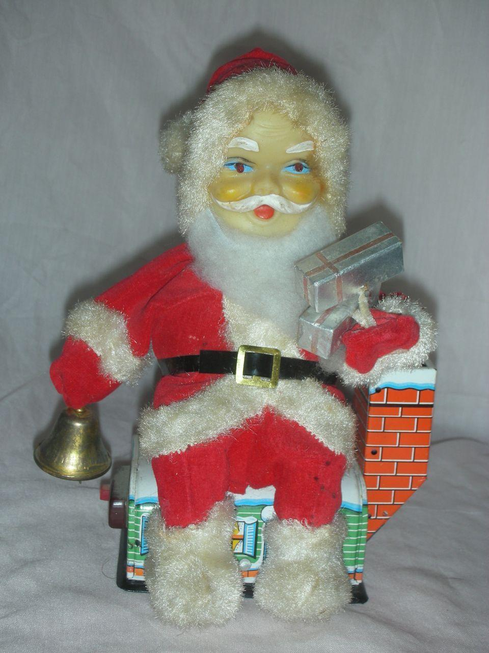 Vintage battery operated santa claus christmas toy from