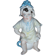 Vintage All Bisque Doll Figurine Sitting on Potty or Chamber Pot Fairing