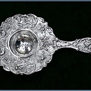 Large Ornate Antique German Silver Tea Strainer: Pan, Figural
