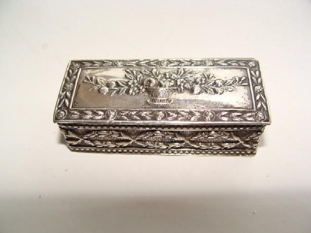 Beautiful 19th century silver box (hallmarked)with chased flowers and leaves