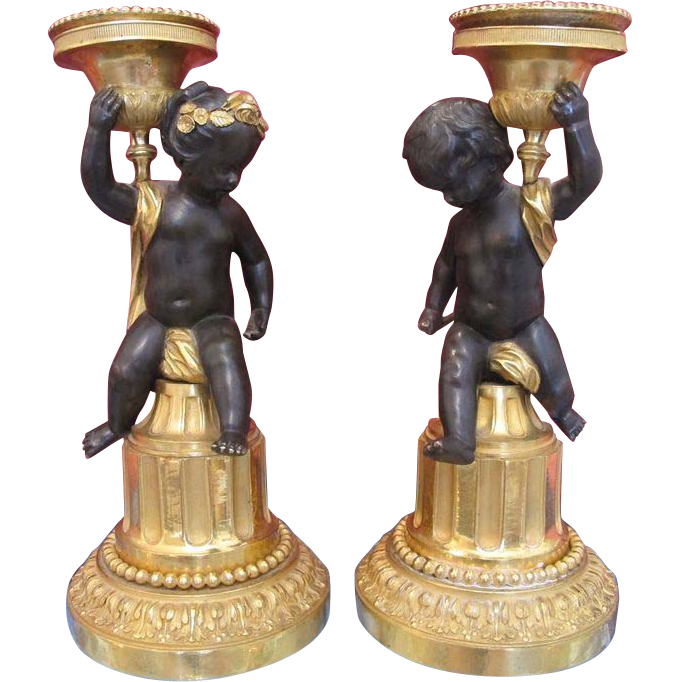 A fine pair of French Empire Gilt and patinated Bronze candle sticks, early 19th century
