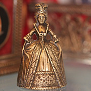 Gilt Bronze dinner bell modelled as a beautiful lady, 19th century
