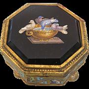 A 19th century Roman Micromosaic enamelled gilt bronze box by Cesare Roccheggiani