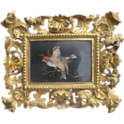 A Pietra Dura Panel set in a fine Florentine gilt wood frame, 19th century