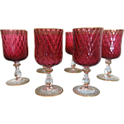 Six Bohemian Cranberry wine goblets with gold and enamel adornment, ca.1900
