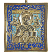 Antique Russian Icon depicting St. Nicholas, gilt metal with royal blue enamelling, early 19th century