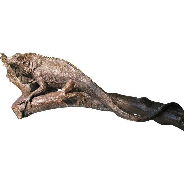 Fine  Bronze modelled and cast as a iguana sitting on a branch, signed Milo