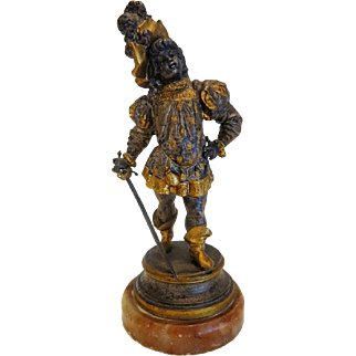 Antique figure of a young nobleman, metal, partly gilded and silver plated, late 19th century