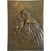 Antique Bronze plaque depicting St. Antonio and the Christ Child, 19th century