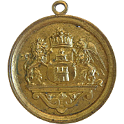 Antique heraldic pendant, gilt metal, dated  1895