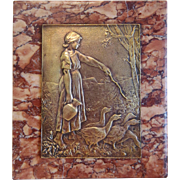 Art Deco Bronze relief depicting a young girl, ca. 1930