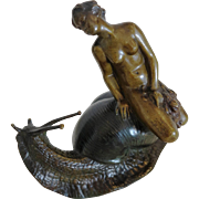 Vienna Bronze figure of a female nude riding on a snail, early 20th century
