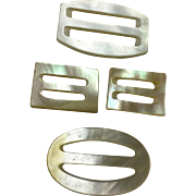 Four Small Mother of Pearl Buckles