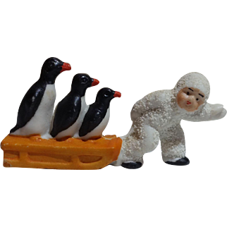 Adorable German Snowbaby Pulling 3 Penguins on a Sled