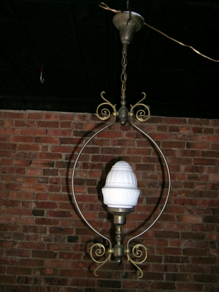 Brass hanging light with it's original pressed milk glass globe