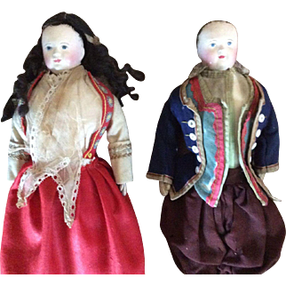 Matched pair of Antique Early German Paper Mache Dolls in French Regional Costume