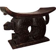 Early 20th century African Carved Wood Figural Stool in the Form of a Spotted Lion Supporting a Shaped Bench in the Art Deco Taste
