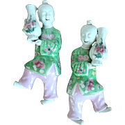 Pair Antique Early 19th century Chinese Porcelain Wall Pockets Ho Ho Boys Holding Vases in Famille Rose Glaze
