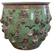 Antique 19th century Chinese Export Porcelain Fish Bowl or Planter Flower Pot Decorated with Precious Objects and Vases in Relief in Famille Rose Palette on Mint Green Ground