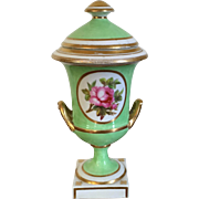 Antique Early 19th century English Regency Derby Porcelain Covered Urn Decorated with Panels of Pansies and Roses on an Apple Green Ground