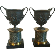 Antique 19th century Grand Tour Patinated & Gilt Bronze Urns Mounted on Egyptian Porphyry Columns with Black Marble Plinths