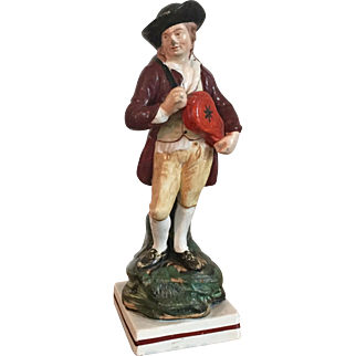 Antique early 19th century English Staffordshire Pearlware Figure of a Musician Playing the Hurdy-gurdy 1800