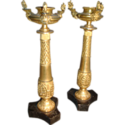 Pair 19th century Gilt Bronze Egyptian Revival Candlesticks or Torchiere in the manner of Thomas Hope Ormolu with Black Marble Bases