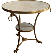 Antique French Gilt Bronze & White Marble Round Gueridon Table in the Empire Taste with Eagle Ring Handles and Talon Feet 19th century