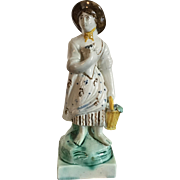 Antique Late 18th / Early 19th century English Staffordshire Pearlware Figure of a Young Girl with a Basket of Flowers