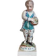 Antique Early 19th century English Staffordshire Pearlware Figure of a Young Boy Holding a Bird's Nest with Chicks