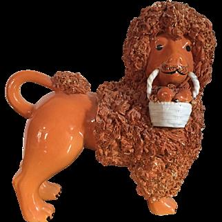 Antique Pottery Figure of a Poodle Holding a Basket of Fruit with Orange Glaze