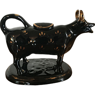 Antique 19th century English Pearlware Jackfield Cow Form Creamer with Black Glaze and Gilt Highlights