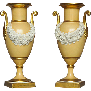 Pair Antique Early 19th century Dagoty Old Paris Porcelain Vases or Urns with Bisque Floral Swags on an Apricot Ground Enhanced by Gilding