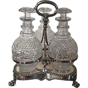 Antique Early 19th century English Old Sheffield Plate Silver on Copper Tantalus with Three Cut Crystal Decanters for Wine or Whiskey Spirits