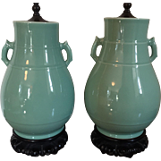 Pair Chinese Art Deco Monochrome Celadon Glaze Vase Urns with Stylized Loop Handles Mounted as Lamps with Carved Wood Bases