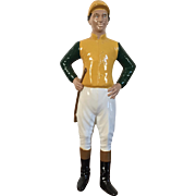 Vintage Heavy Iron Desk Top Statue of a Lawn Jockey Dressed in Silks, Cap, Jodhpurs, Boots and Carrying a Riding Crop Mounted on Mahogany Base Door Stop