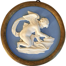 Antique 19th century Wedgwood Light Blue Jasperware Plaque of Cupid in High Relief in Period Regency Gilt Wood Frame