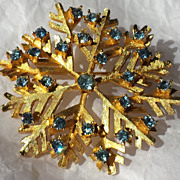 DODDS Ice Blue Rhinestone and Gold-tone Snowflake Broach