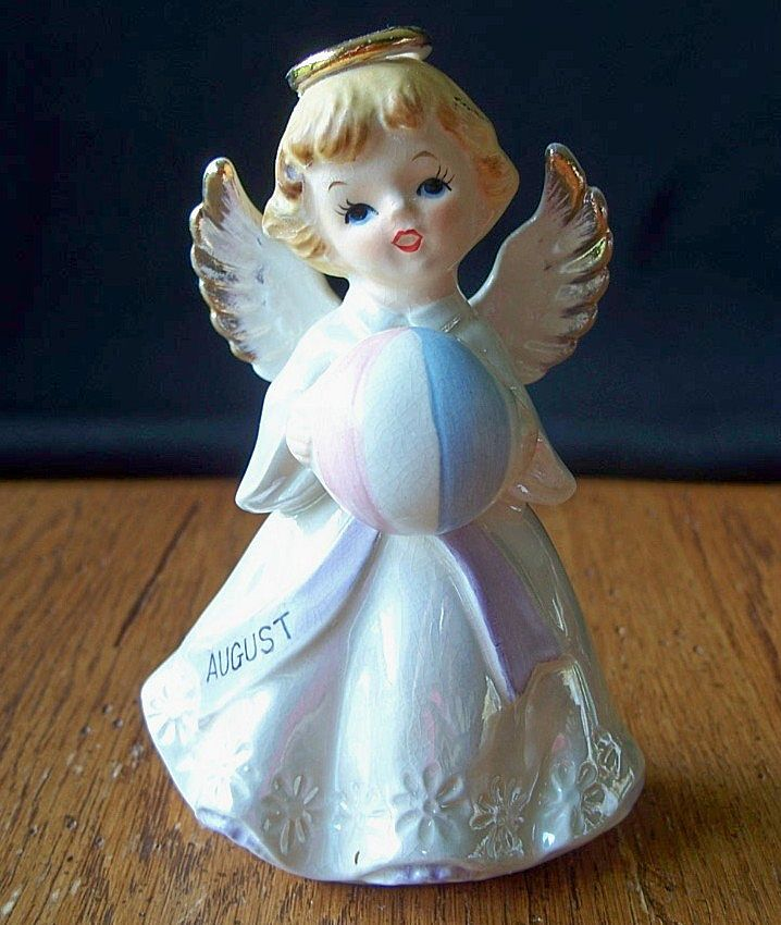 August Angel Holding A Beach Ball Figurine