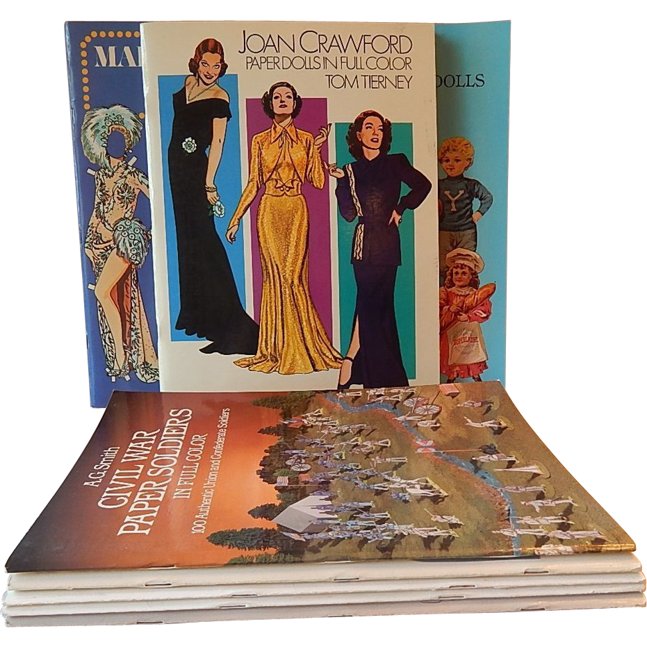 Eight Uncut Paper Doll Books