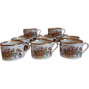Eight Fitz & Floyd St. Nicholas Cups and Saucers