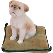Adorable Porcelain Pug Dog on Pillow